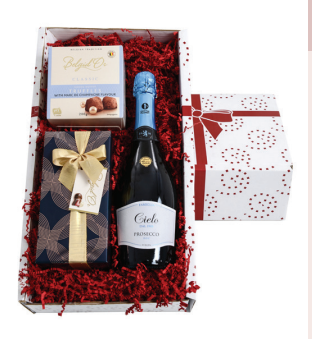 A bottle of Prosecco, truffles and chocolates in a gift pack